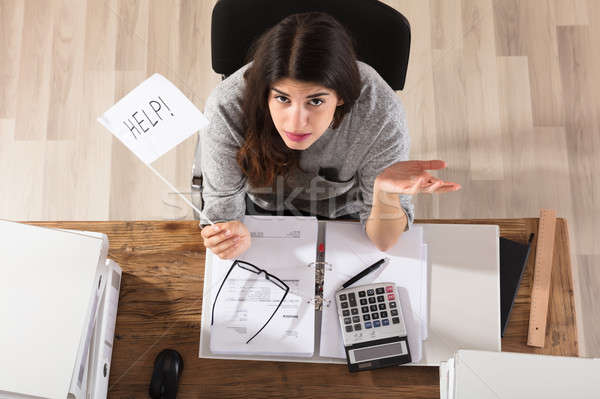 Businesswoman Showing Help Flag In Office Stock photo © AndreyPopov