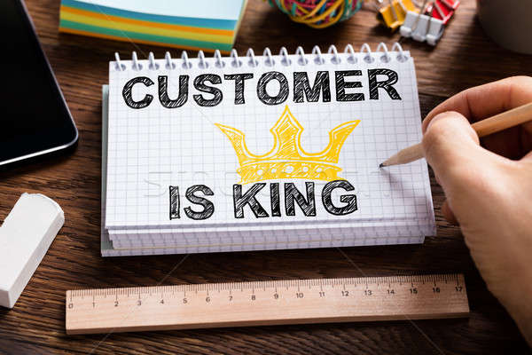 Person Drawing Customer Is King Chart On Note Book Stock photo © AndreyPopov