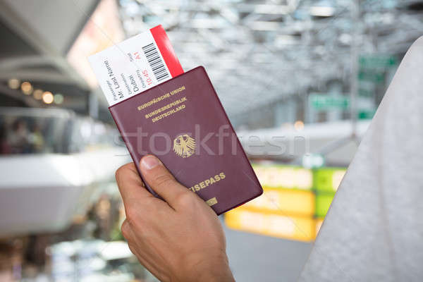 Hand Holding Passport And Boarding Pass Stock photo © AndreyPopov