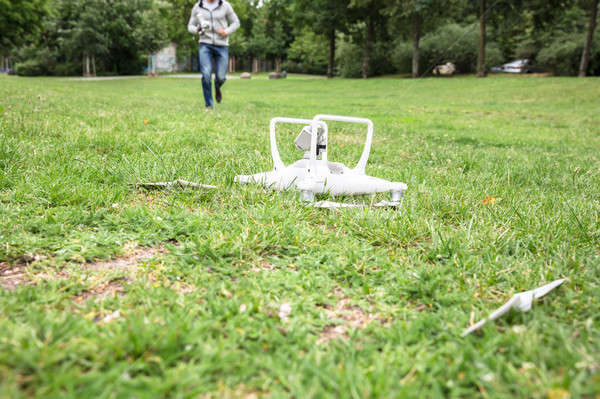 Quadrocopter Fallen On Grass Stock photo © AndreyPopov