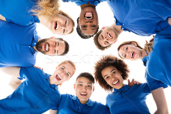 Group Of Smiling Janitors Forming Huddle Stock photo © AndreyPopov