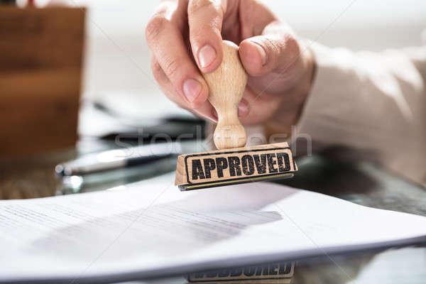 Persona approvato timbro documento primo piano Foto d'archivio © AndreyPopov