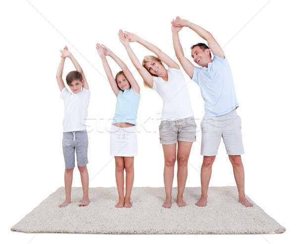 Couple With Their Two Children Exercising Stock photo © AndreyPopov