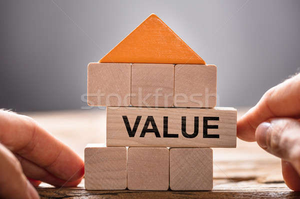 Hands Building House Model With Value Block Stock photo © AndreyPopov
