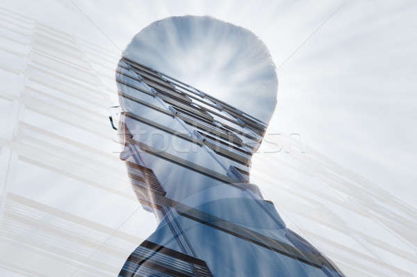 Verdubbelen blootstelling zakenman wolkenkrabber zonlicht stad Stockfoto © AndreyPopov