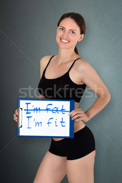 Young Woman Holding I'm Fit Text Stock photo © AndreyPopov