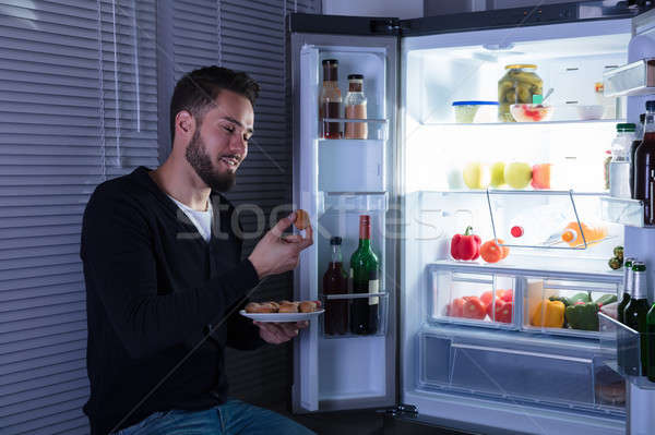 Man Eating Cookie Stock photo © AndreyPopov