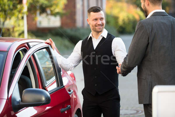 Smiling Valet And Businessperson Standing Near Car Stock photo © AndreyPopov
