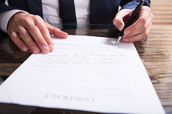 Businessperson Filling Contract Form Stock photo © AndreyPopov