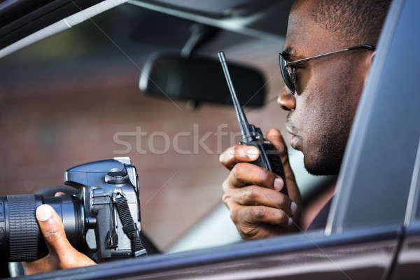 Dedektif oturma içinde araba kamera Stok fotoğraf © AndreyPopov