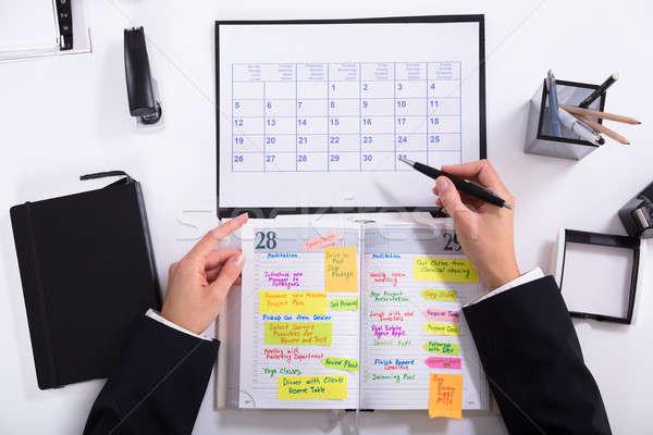 Businesswoman Marking Schedule Stock photo © AndreyPopov