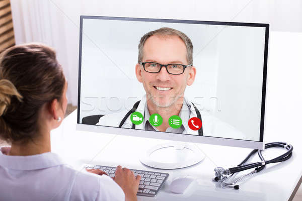 Woman Video Conferencing With A Male Doctor Stock photo © AndreyPopov