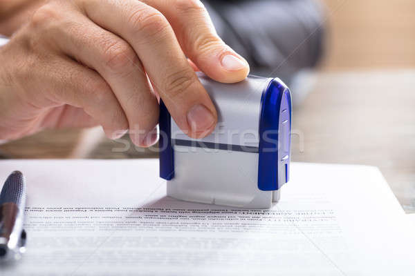Human Hand Stamping Document Stock photo © AndreyPopov