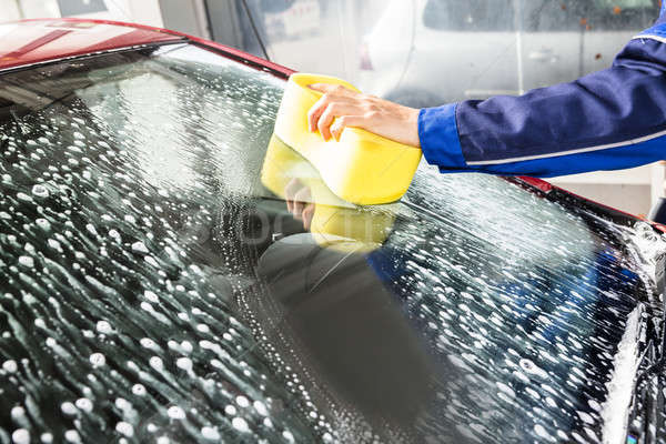 Hand Cleaning Car Windshield With Sponge Stock photo © AndreyPopov