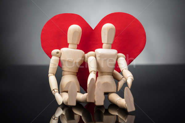Wooden Dummy Couple Leaning On Heart Shape Stock photo © AndreyPopov