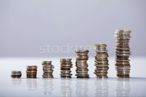 Stack Of Increasing Coins On Desk Stock photo © AndreyPopov