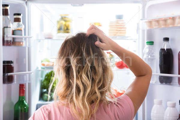 путать женщину глядя открытых холодильнике вид сзади Сток-фото © AndreyPopov