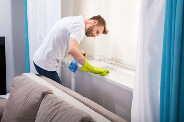 Janitor Cleaning Windowsill With Sponge Stock photo © AndreyPopov