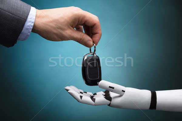 Businessperson Giving Car Key To Robot Stock photo © AndreyPopov