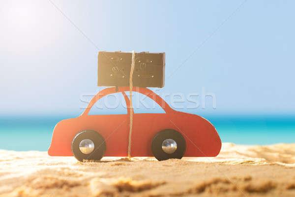 Piros autó csomagok homokos tengerpart közelkép napos idő Stock fotó © AndreyPopov