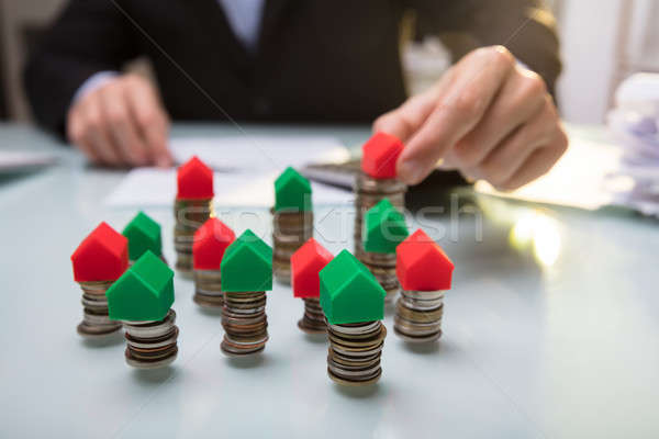 Close-up Of Green And Red House Model On Stacked Coins Stock photo © AndreyPopov