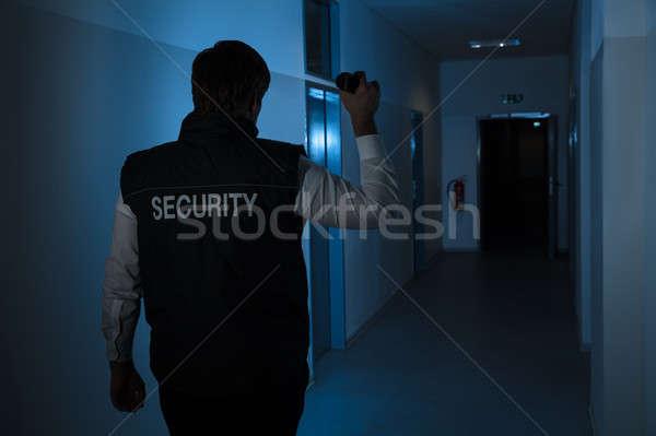 Guarda de segurança em pé corredor edifício parede Foto stock © AndreyPopov