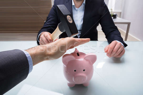 Businessman Stopping His Colleague From Breaking Piggybank Stock photo © AndreyPopov