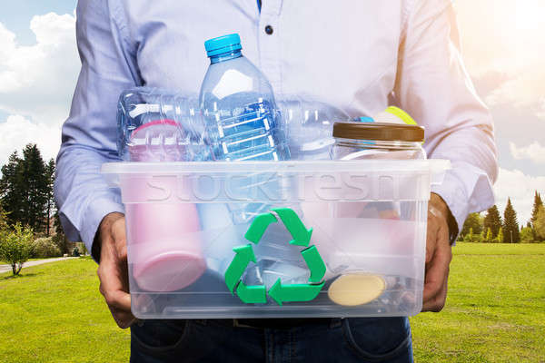 Person Carrying Container Full Of Used Plastic Bottles Stock photo © AndreyPopov