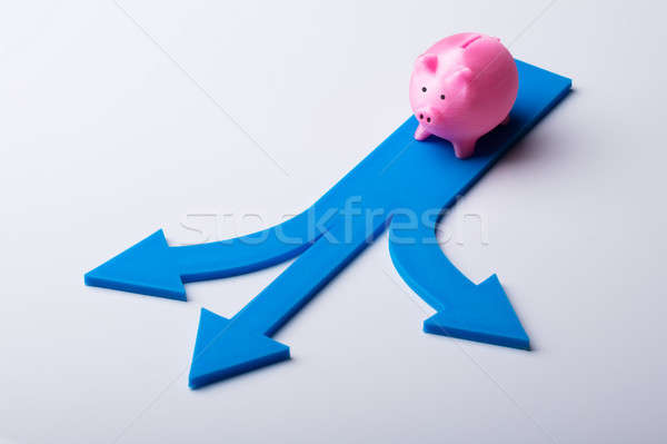 Elevated View Of Pink Piggybank And Blue Arrow Signs Stock photo © AndreyPopov