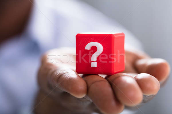 Question Mark Block On Person's Hand Stock photo © AndreyPopov