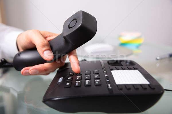 Businessman Calling On Landline Stock photo © AndreyPopov