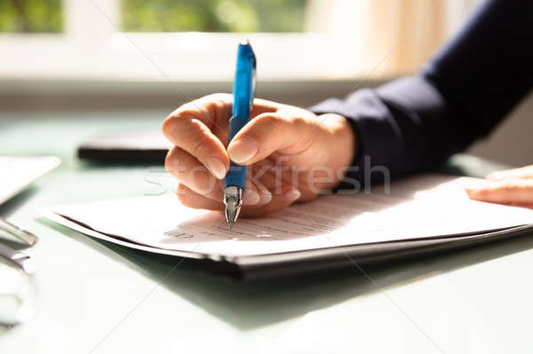 Businesswoman Filling Contract Form Stock photo © AndreyPopov