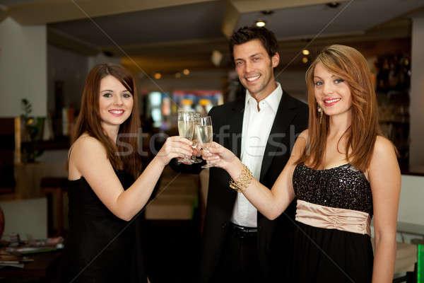 Amigos champanhe foco óculos comida Foto stock © AndreyPopov
