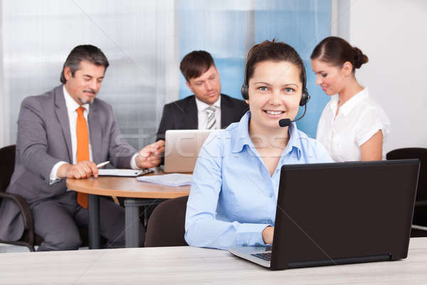 Female Customer Care Executive Working At Office Stock photo © AndreyPopov