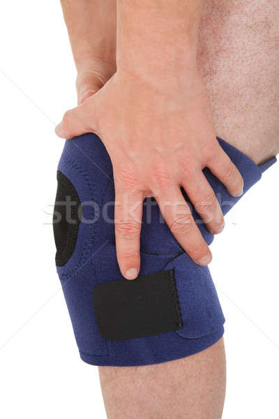 Close-up Of Man Wearing Knee Brace Stock photo © AndreyPopov