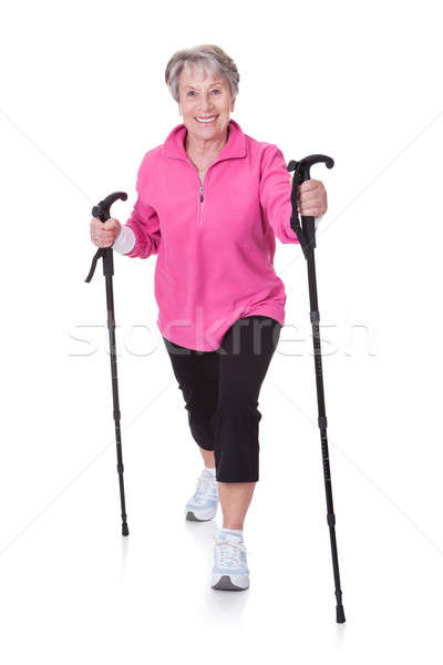 Senior Woman Walking With Hiking Poles Stock photo © AndreyPopov