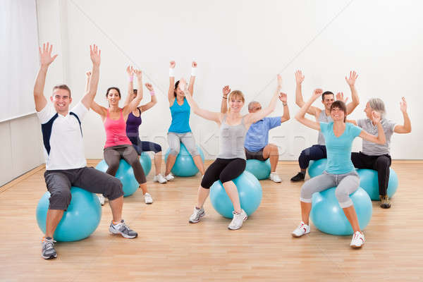 Large group of people doing pilates Stock photo © AndreyPopov