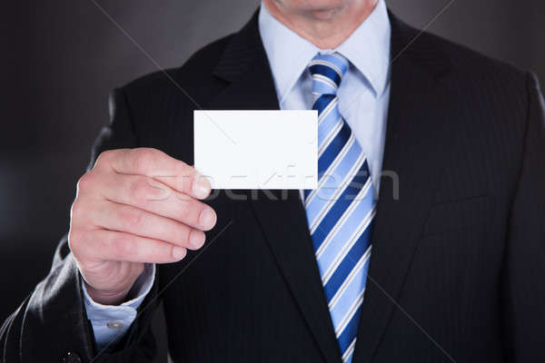 Close-up Of Businessman Holding Visiting Card Stock photo © AndreyPopov