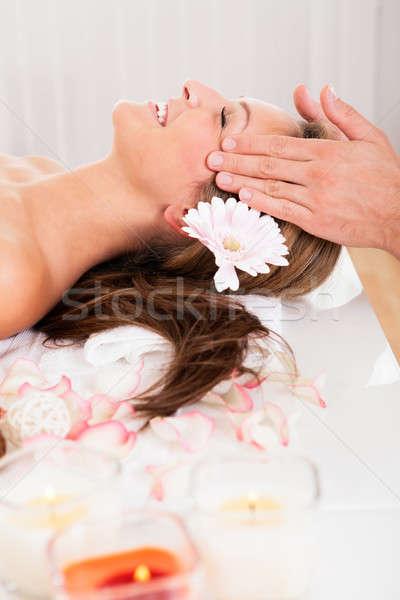 Gyönyörű nő élvezi spa kezelés virág haj mosolyog Stock fotó © AndreyPopov