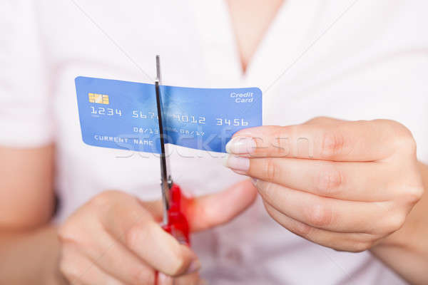 Female Cutting Credit Card Stock photo © AndreyPopov