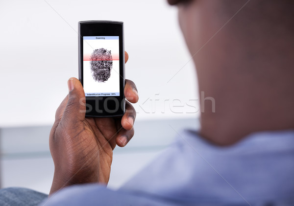 Mobile Phone Authentication Using Fingerprint Scan Stock photo © AndreyPopov