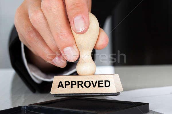 Kéz tart pecsét elismert felirat közelkép Stock fotó © AndreyPopov