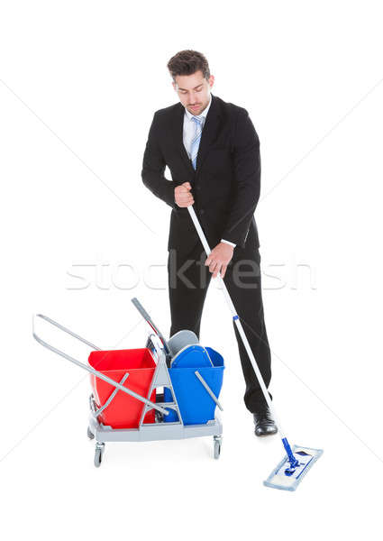 Businessman Mopping Over White Background Stock photo © AndreyPopov
