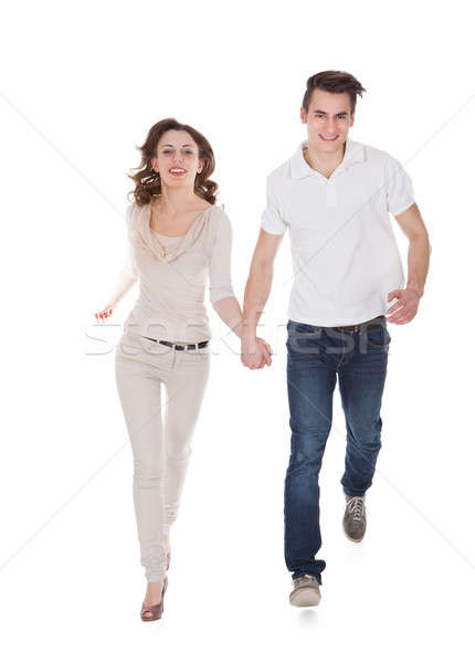Couple In Casuals Walking Over White Background Stock photo © AndreyPopov