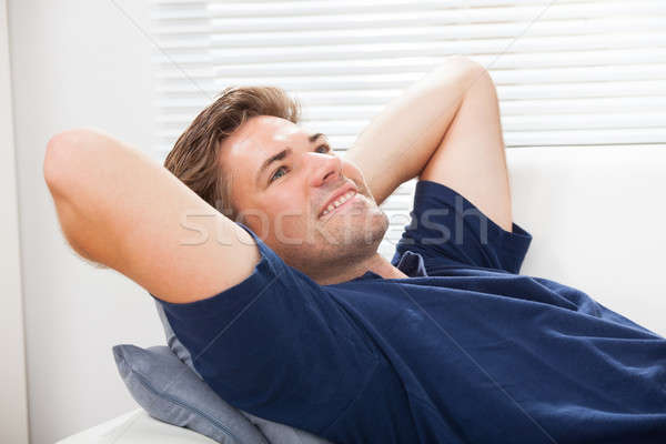 Man Lying On Sofa At Home Stock photo © AndreyPopov