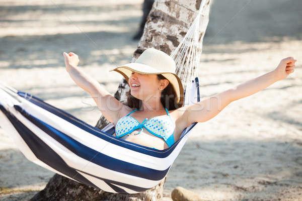 Nő nyújtás függőágy tengerpart boldog fiatal nő Stock fotó © AndreyPopov