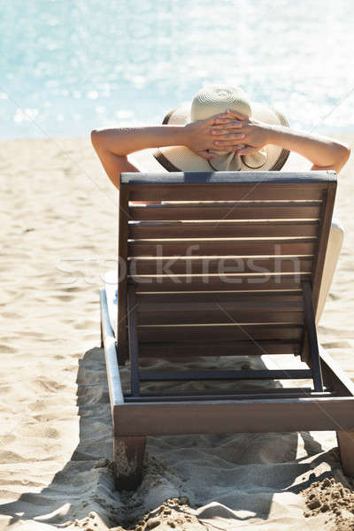 Stock photo: Woman relaxing on deck chair at tropical beach