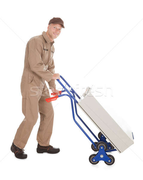 Delivery Postman Pushing Machine On Cart Stock photo © AndreyPopov