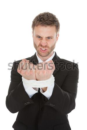 Frustrated Businessman Looking At Tied Hands Stock photo © AndreyPopov