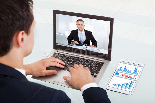 Businessman Video Conferencing On Laptop In Office Stock photo © AndreyPopov